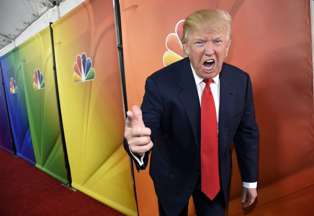Joanna Weiss: Donald Trump's tenuous relationship with the political press is based on a misunderstanding. In this photo, the entertainer turned presidential candidate mugs for photographers at the NBC 2015 Press Tour at The Langham Huntington Hotel on Friday, Jan. 16, 2015, in Pasadena, Calif. (Chris Pizzello/AP)