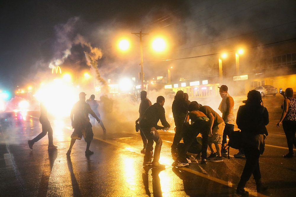 Police fire tear gas at demonstrators protesting the shooting of Michael Brown after they refused to honor the midnight curfew on August 17, 2014 in Ferguson, Missouri.  (Scott Olson/Getty Images)