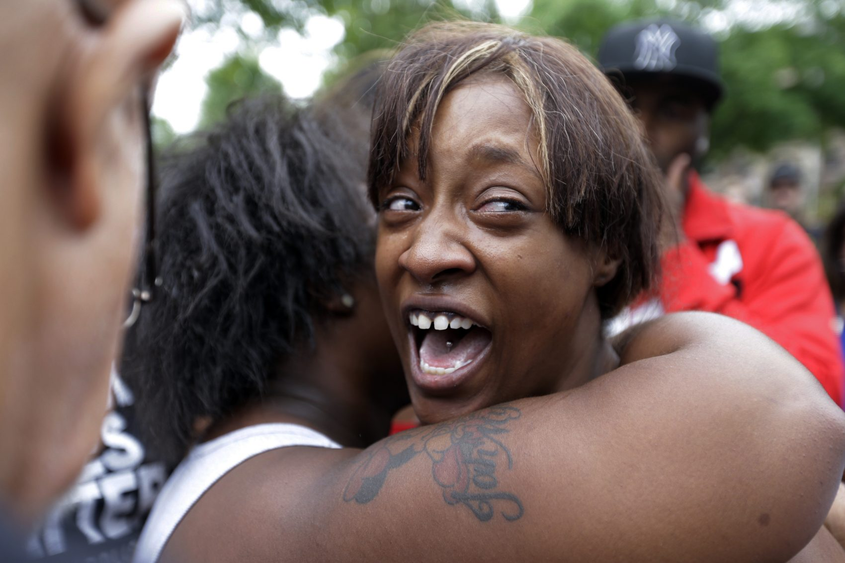 Diamond Reynolds, the girlfriend of Philando Castile, is consoled as she talks about his shooting death with protesters and media outside the governor's residence in St. Paul, Minn. (Jim Mone/AP)