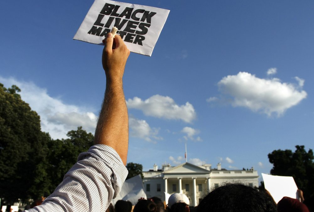Protesters stand outside of the White House protesting police brutality on Friday, July 8, 2016, in Washington (Sarah Grace Taylor/AP)