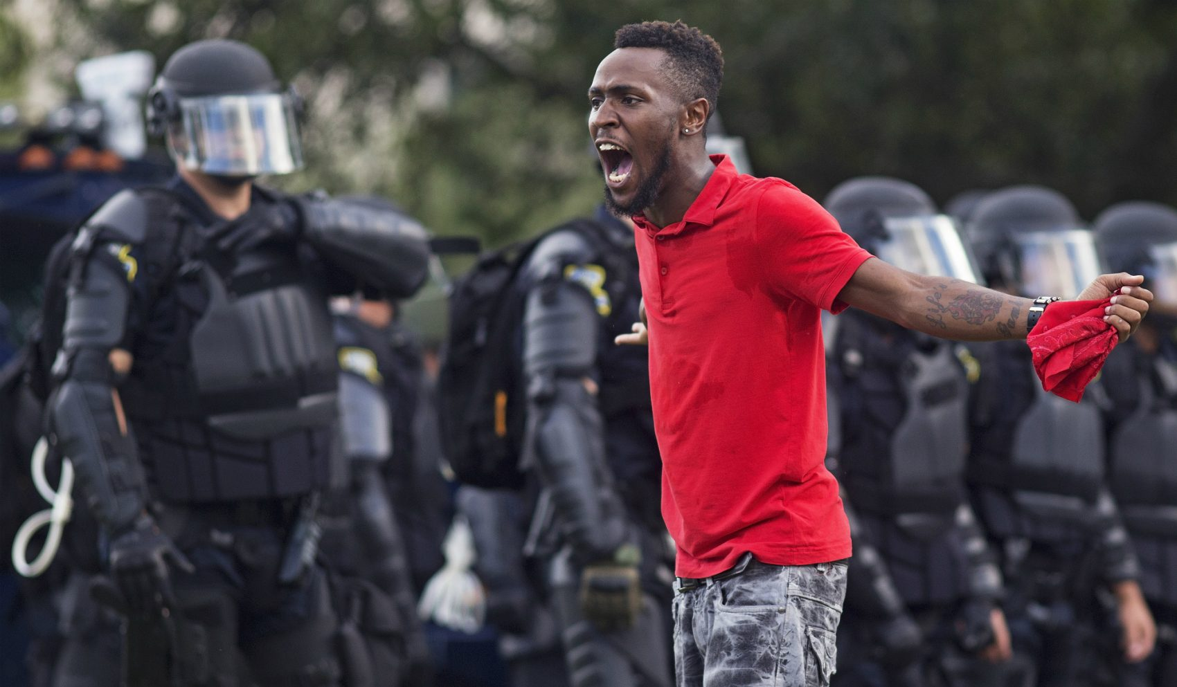 A protester yells at police in front of the Baton Rouge Police Department headquarters after police arrived in riot gear to clear protesters from the street in Baton Rouge, La., Saturday, July 9, 2016. Several protesters were arrested. (Max Becherer/AP)