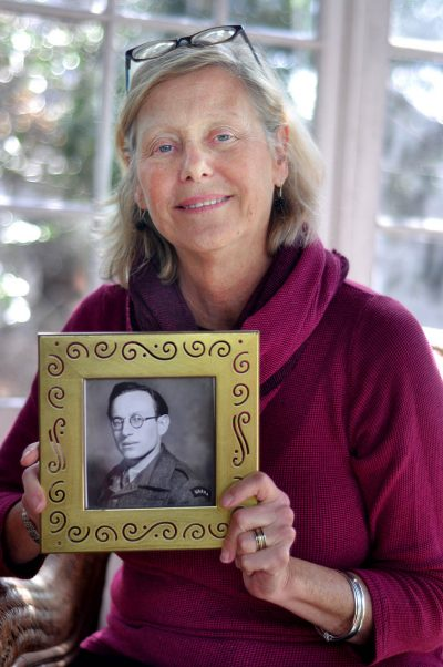 Kris Fayerman-Piatt holds a picture of her father, Severin Fayerman, before he came to America. (Michelle O'Berg Figueroa for WBUR)