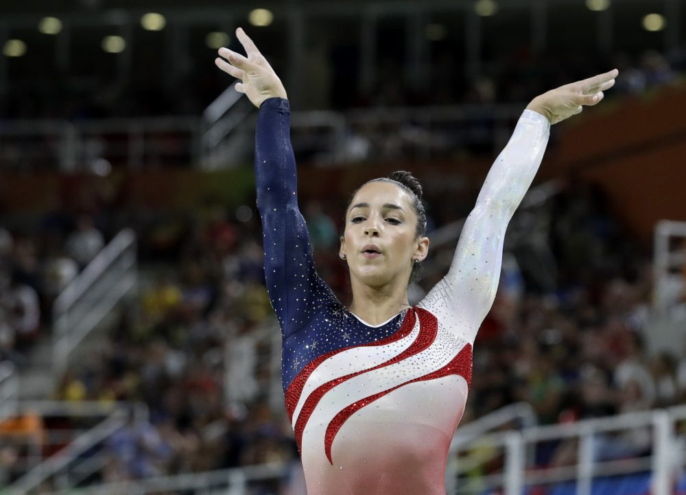 United States' Aly Raisman performs on the balance beam during the artistic gymnastics women's team final at the 2016 Summer Olympics in Rio de Janeiro, Brazil, Tuesday, Aug. 9, 2016. (Rebecca Blackwell/AP)
