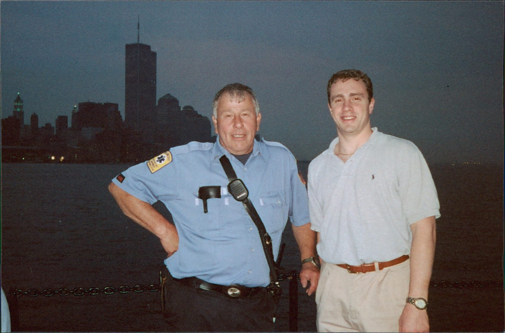 Crowther stands with Harry Wanaker, a lieutenant in the Nyack Fire Department. Lower Manhattan and the World Trade Center towers are visible in the background. (Courtesy The Crowther Family)