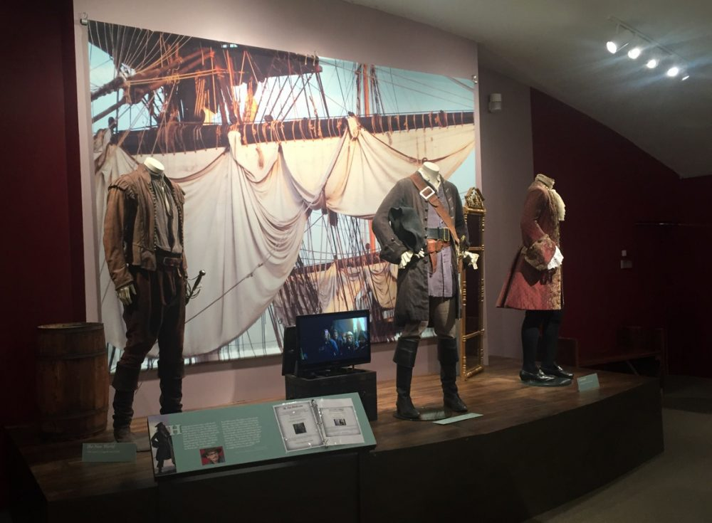 "Jack Sparrow's ""Pirates of the Caribbean: The Curse of the Black Pearl"" costume (by Penny Rose) is flanked on the left by Colin Farrell as Captain John Smith in ""The New World"" (by Jacqueline West) and on the right by Heath Ledger as Giacomo Casanova in ""Casanova"" (by Jenny Beavan). (Erin Trahan for WBUR)"