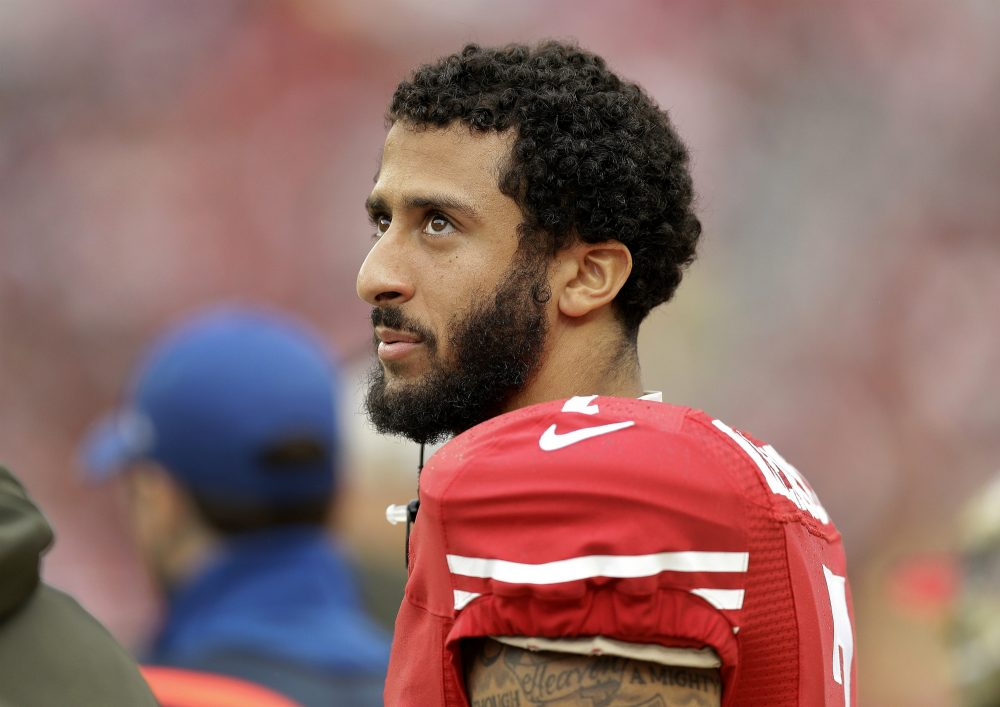 A veteran, Andrew Carleen argues that the NFL player's refusal to stand during the national anthem isn't an insult to America's troops. Our country's shallow definition of what passes for patriotism is.  Pictured: San Francisco 49ers quarterback Colin Kaepernick stands on the field during an NFL football game against the Atlanta Falcons in Santa Clara, Calif., in 2015. (Ben Margot/AP)