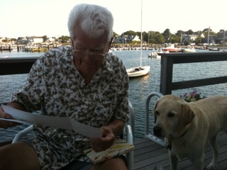 "William Barney works on the family genealogy on the deck of his home on Nantucket, ""The Barnacle."" (Courtesy Libby Holman)"