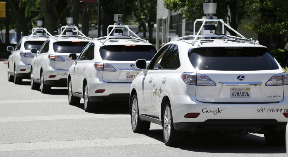 Massachusetts is moving toward providing a regulatory framework for testing autonomous vehicles in the state. Pictured: A row of Google self-driving Lexus cars at the Computer History Museum in Mountain View, California. (Eric Risberg/ AP)
