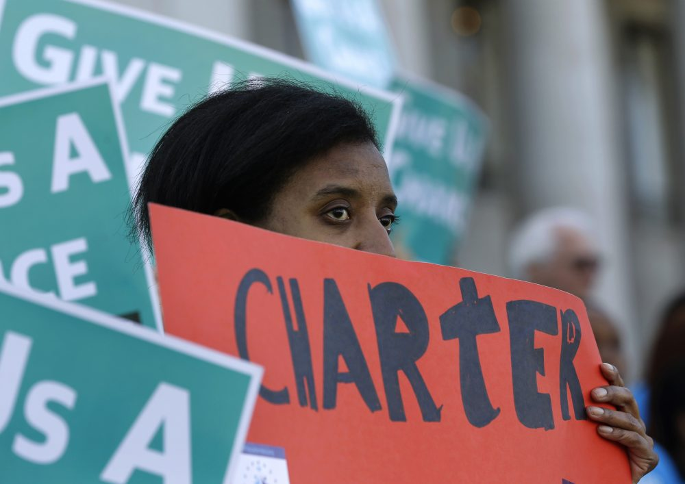 Lavinda Trammell, of Tacoma, Wash., who said she is a parent of a child that attends a charter school, holds a sign during a rally in support of public charter schools at the Capitol in Olympia, Wash. on Feb. 25, 2016. (Ted S. Warren/AP)