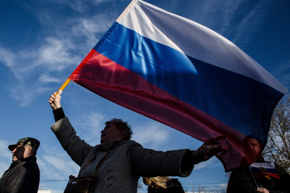 Crimeans wave Russian flags as they celebrate the first anniversary of the referendum on March 16, 2015 in Sevastopol, Crimea. (Alexander Aksakov/Getty Images)