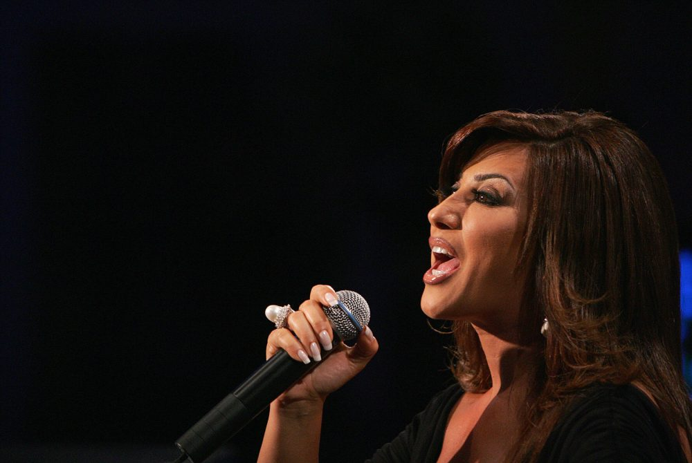 "Lebanese singer Najwa Karam performs during the season's last episode of MBC's ""Al-Arrab"" show in downtown Beirut on May 30, 2008. (Anwar Amro/Getty Images)"