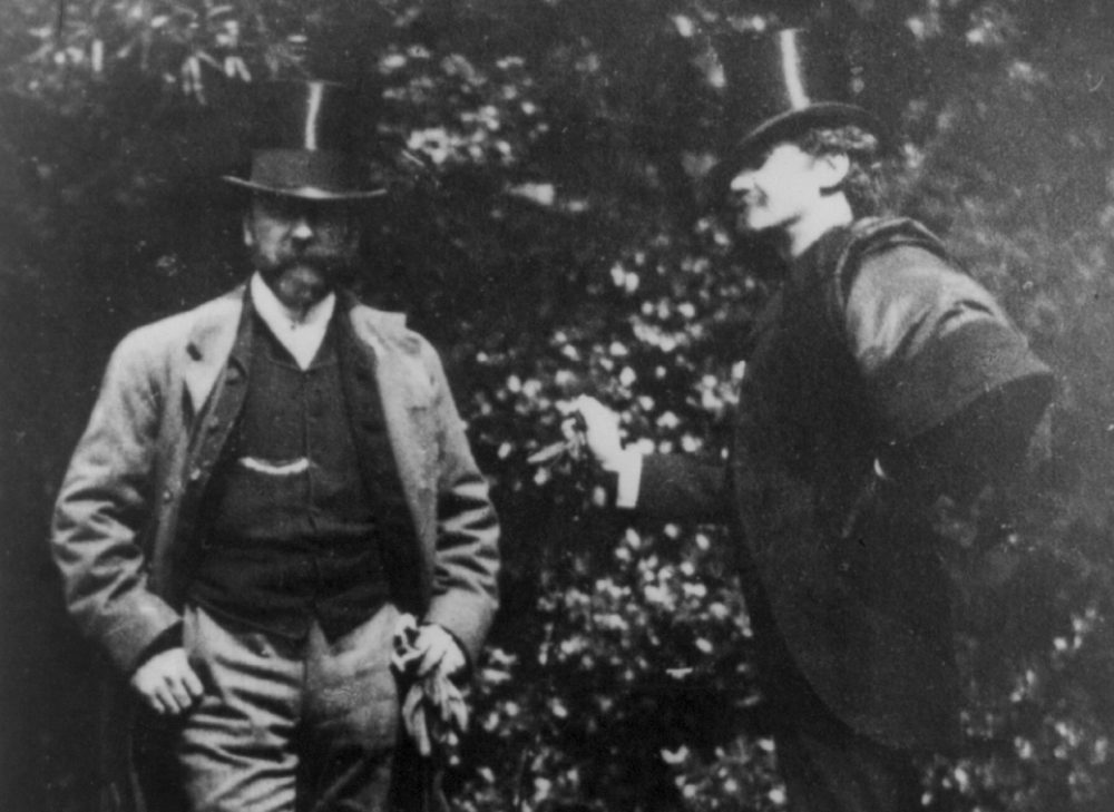 A portrait of artists William Merritt Chase and James Abbott McNeill Whistler standing in a yard around 1885. (Courtesy Library of Congress)