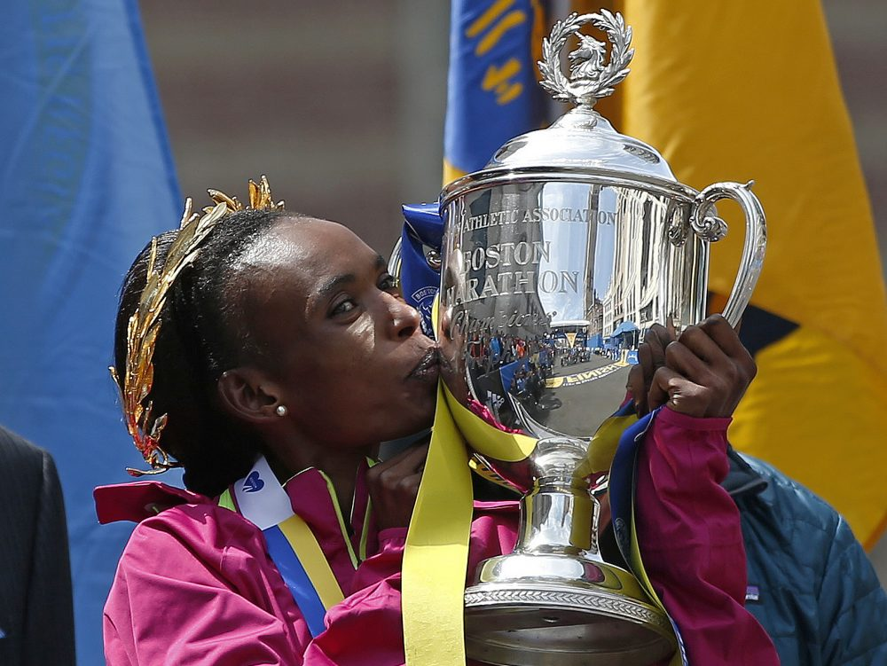 In this April 21, 2014 file photo, Rita Jeptoo of Kenya kisses the trophy after winning the women's division of the 118th Boston Marathon in Boston. On Wednesday, Jeptoo was stripped of that victory for alleged doping. (Elise Amendola/AP)