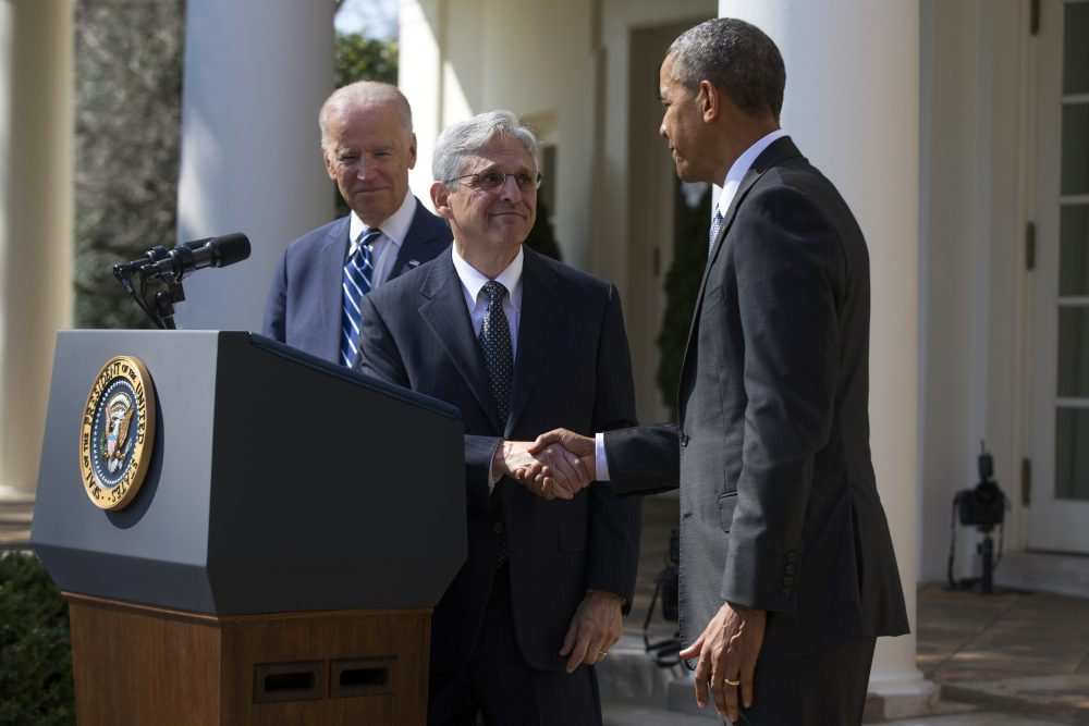 Federal appeals court Judge Merrick Garland, center, shakes hands with President Obama, right, as Vice President Joe Biden watches during his introduction as Obama''s nominee for the Supreme Court in the Rose Garden of the White House on March 16. (Evan Vucci/AP)