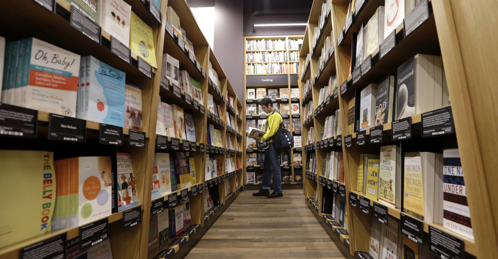 Commentary amazon should leave brick and mortar to the little guys a customer shops at the opening day for amazon books the first brick and solutioingenieria Gallery