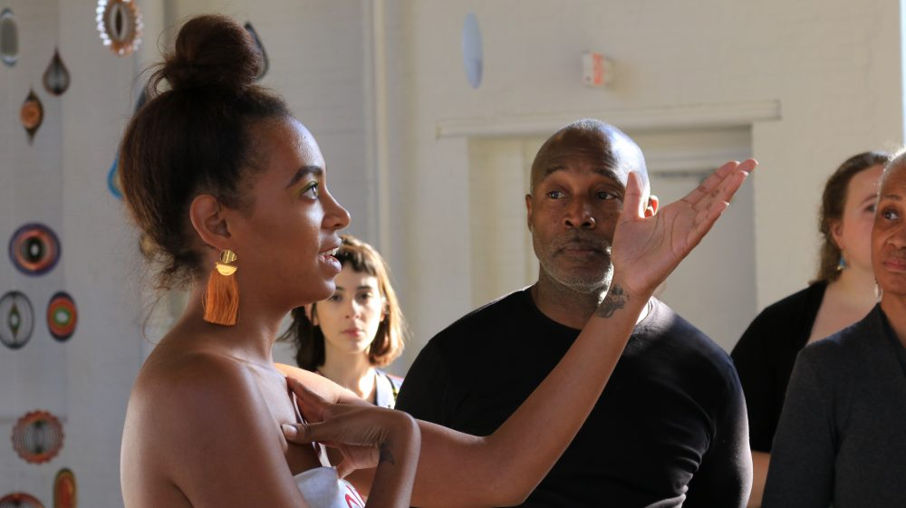 "Musician Solange Knowles reacts to ""Until""  as artist Nick Cave looks on. (Courtesy John Tibbets/MASS MoCA)"