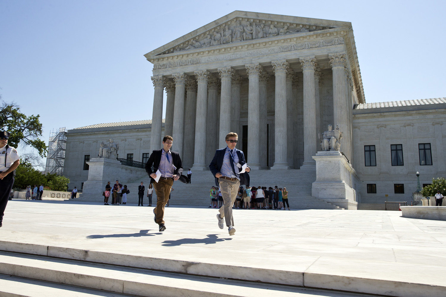 The Supreme Court is set to begin its new term as it ended the last one, down one justice and ideologically deadlocked on a range of issues. (Alex Brandon/AP)