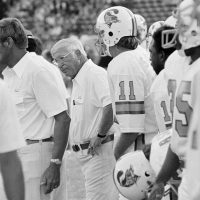 Coach John McKay and members of the 1976 Buccaneers watch as Tampa Bay loses to the Los Angeles Rams, 26-3, at the Coliseum, July 31, 1976. (George Brich/AP)