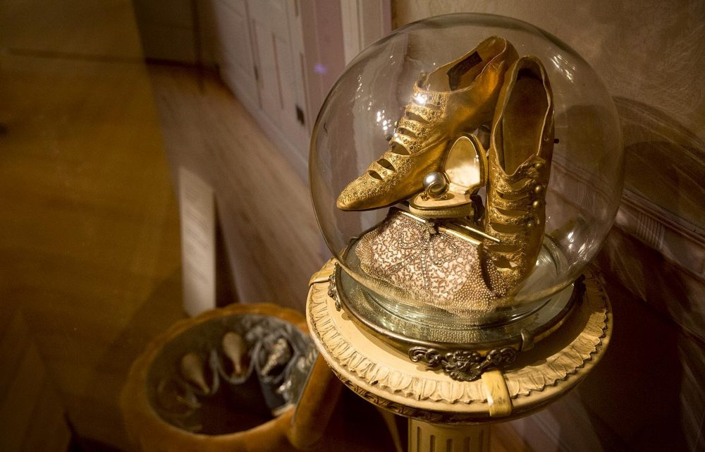 Early 20th century shoes, purse and ring from Raye's collection at the Peabody Essex Museum. (Robin Lubbock/WBUR)