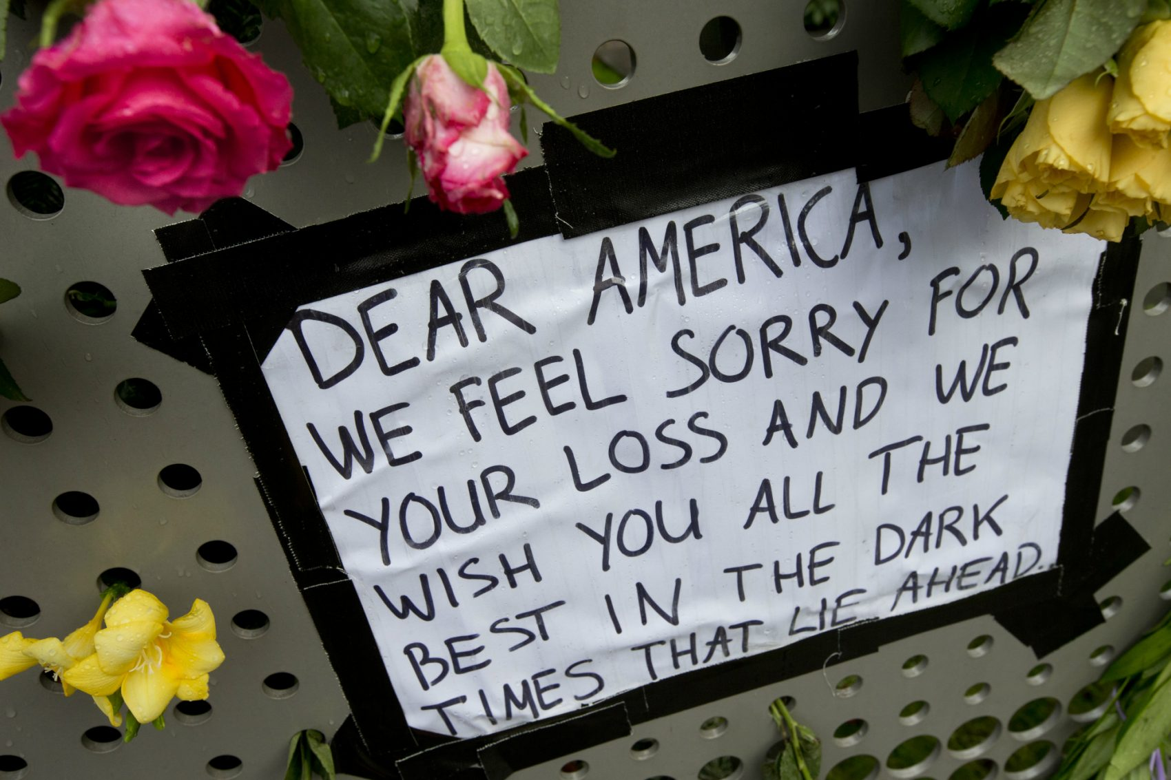 We all want to be counted among the popular majority, writes Ruth Allen, because our vote was for U.S. engagement with the world. Pictured: Raindrops sit on a rose next to a sign put up in reaction to the outcome of the U.S. presidential election at the U.S. consulate in Amsterdam, Netherlands, Thursday, Nov. 10, 2016. (Peter Dejong/AP)