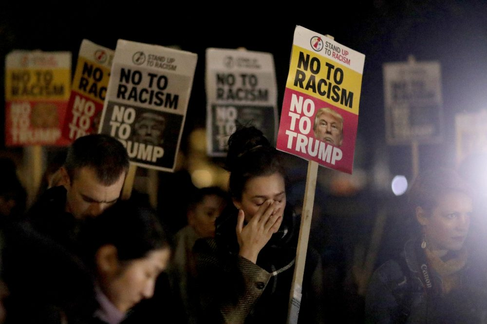 A woman holding a placard wipes away tears as she takes part in an anti-racism protest against President-elect Donald Trump winning the American election, outside the U.S. embassy in London, Wednesday, Nov. 9, 2016. (Matt Dunham/AP)