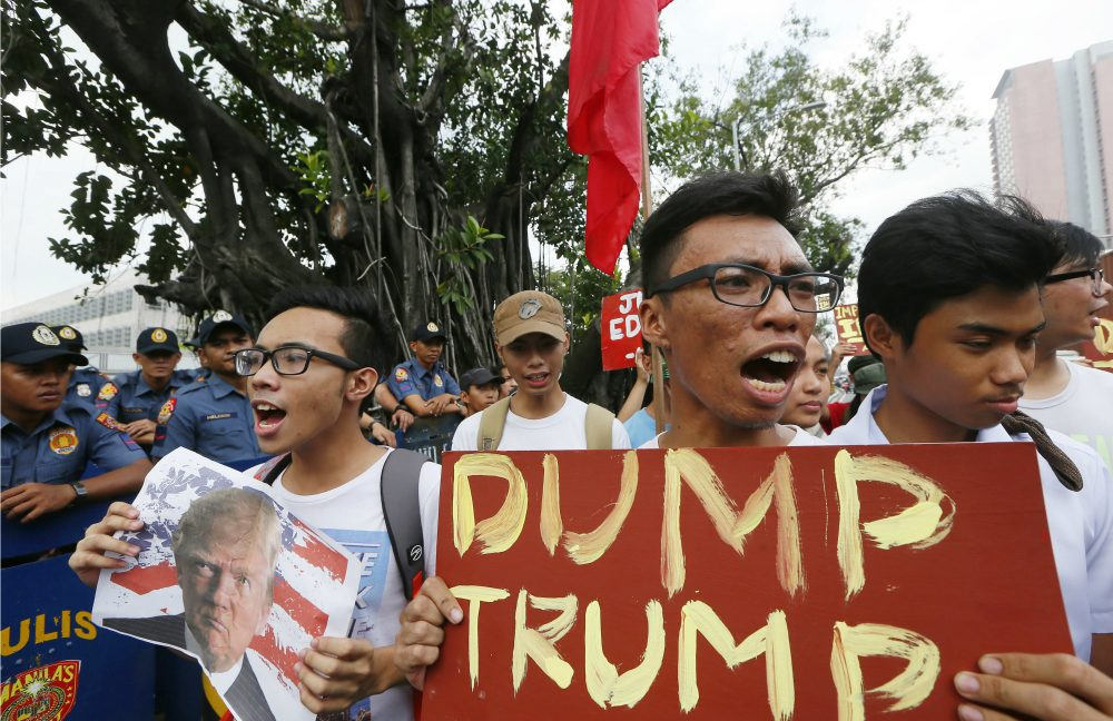 Filipino protesters shout slogans to denounce the election of U.S. President-elect Donald Trump in an anti-U.S. protest at the US Embassy in Manila, Philippines Thursday, Nov. 10, 2016 in Manila, Philippines. (Bullit Marquez/AP)