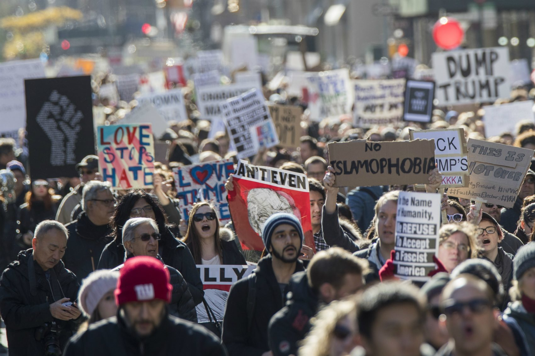 If we want President Trump to reckon with the human toll of his rhetoric and his most dangerous proposals, writes Steve Almond, we have to confront him with our humanity. Pictured: Demonstrators march up 5th Avenue during a protest against the election of President-elect Donald Trump, Saturday, Nov. 12, 2016, in New York. (Mary Altaffer/AP)