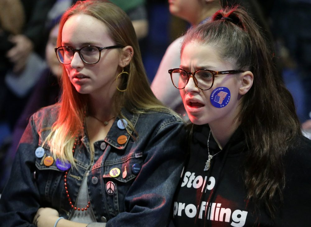 Emma Finnamore, of Maplewood, N.J., left, and Rayah Naji, of Boston, right, react while watching televised election returns Tuesday, Nov. 8, 2016 during a watch party at Wellesley College. (Steven Senne/AP)