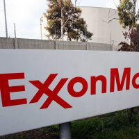 This Jan. 30, 2012, file photo shows the sign for the Exxon Mobil Torrance Refinery in Torrance, Calif. (Reed Saxon/AP)