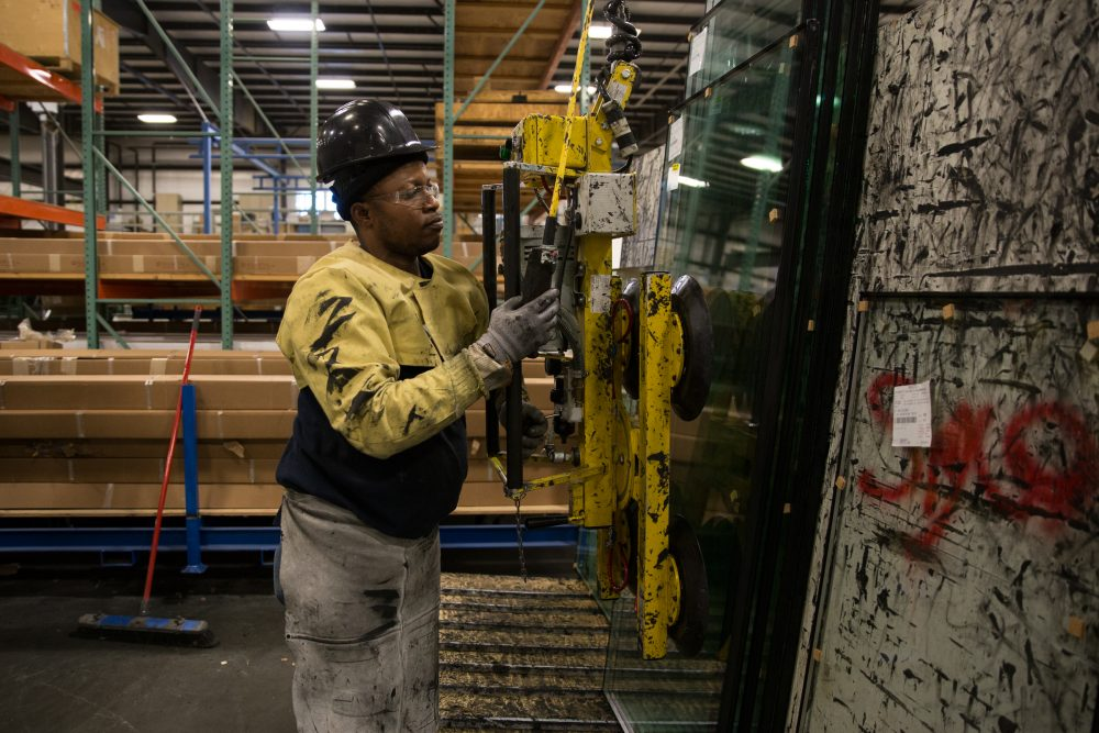 About a third of workers at SIGCO, in Westbrook, Maine, are immigrants. Worker Antonio Pedro came to the United States from Angola three years ago. (Ryan Caron King/NENC)