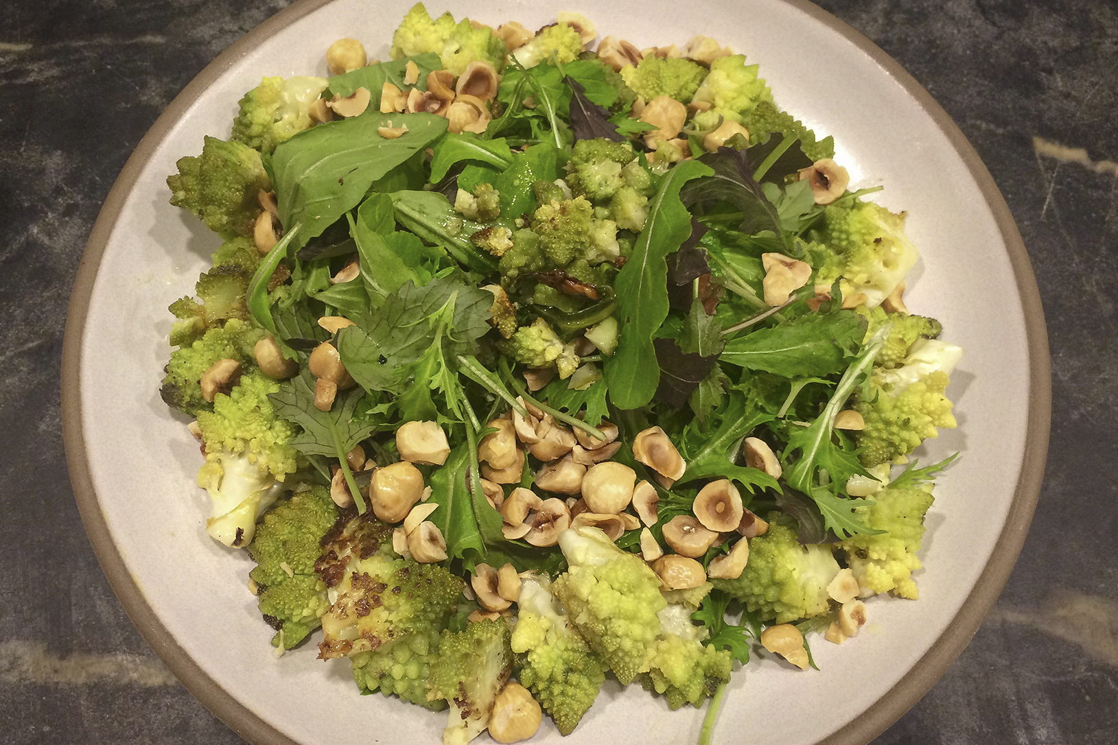 Kathy's roasted cauliflower salad with winter greens, toasted hazelnuts and tahini vinaigrette. (Kathy Gunst for Here & Now)