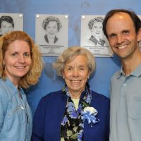 Mount Holyoke athletic director Lori Hendricks (left), Imogene Fish and associate professor of environmental studies Tim Farnham stand in front of Ms. Fish's plaque at the 2013 Mount Holyoke College Athletic Hall of Fame induction ceremony. (RJB Sports Photography)