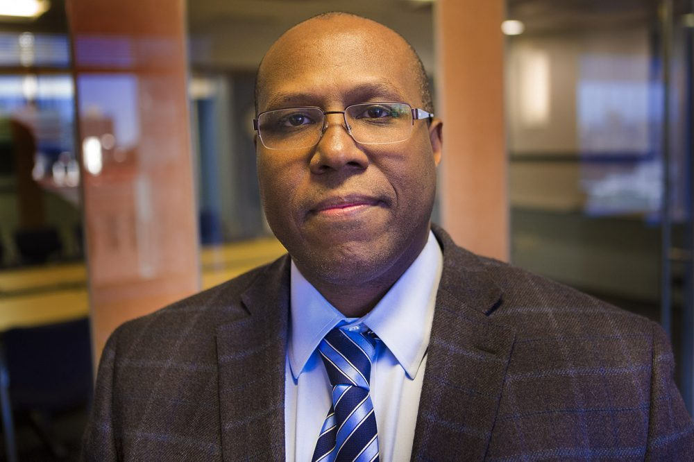 "Dr. Christoper Lathan says poor adults are more likely to get cancer. ""Not only are you more likely to get cancers, you're less likely to go to the physician to have your cancer treated. And then, unfortunately, you're more likely to die earlier."" (Jesse Costa/WBUR)"