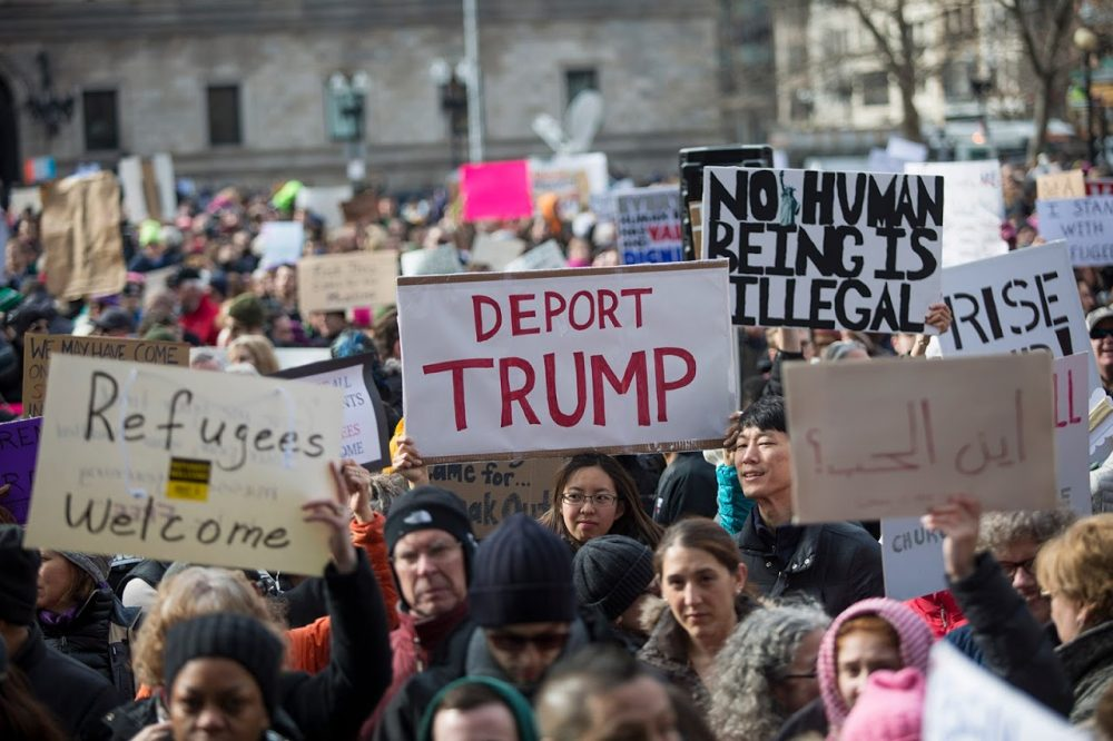 On Sunday, Copley Square was awash with signs protesting the executive order given by Donald Trump to temporarily halt immigration from seven majority-Muslim countries. (Jesse Costa/WBUR)