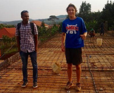 Evan Petty (right) and Allen VR Stanley's engineer on the roof of the gymnasium the school is building. (Courtesy Evan Petty)