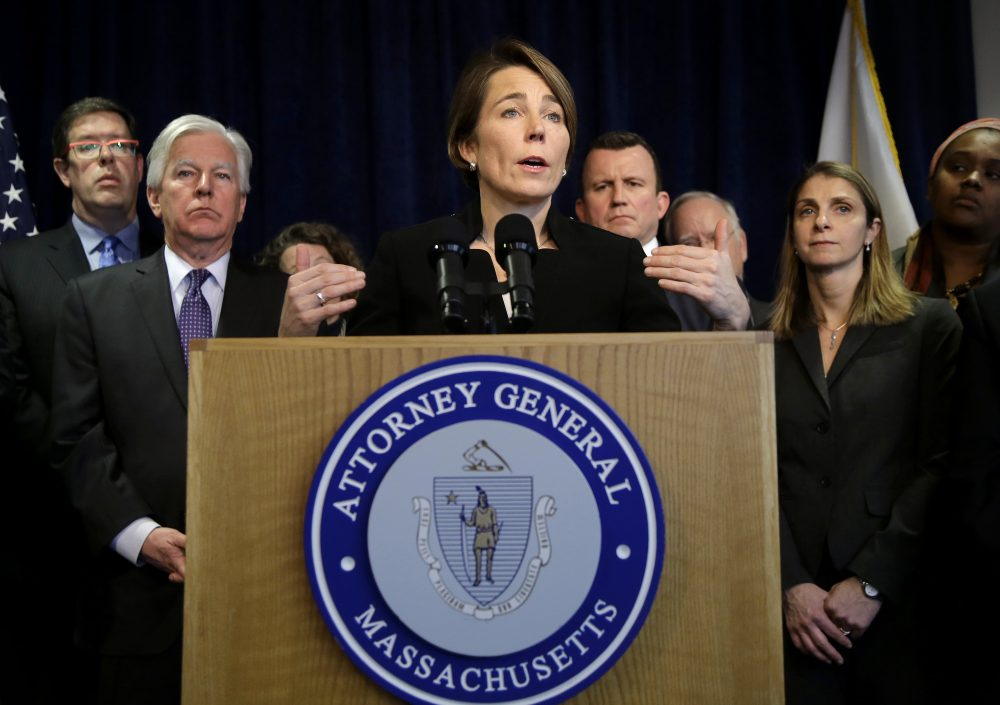 Massachusetts Attorney General Maura Healey is joining a lawsuit filed by the American Civil Liberties Union of Massachusetts challenging President Donald Trump's executive order on immigration. Martin Meehan, president of the University of Massachusetts, stands second from left. (Steven Senne/AP)
