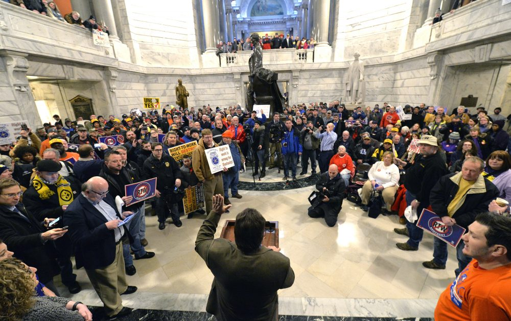 Union leaders speak as protesters fill the Kentucky Capitol rotunda in protest of a House bill making it illegal for workers to have to join a labor union or pay dues to keep a job, in January 2017, in Frankfort, Ky. (Timothy D. Easley/AP)