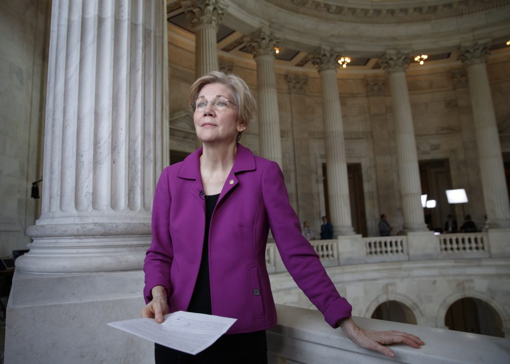 Sen. Elizabeth Warren holds a transcript of the speech that got her barred participating in debate on the Senate floor about Jeff Sessions nomination to be named attorney general. (J. Scott Applewhite/AP)