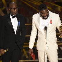 "In the 87-year history of the Academy Awards, only four black writers have won Oscars for screenplays, writes John Vercher. Pictured: Barry Jenkins, left, and Tarell Alvin McCraney accept the award for best adapted screenplay for ""Moonlight"" at the Oscars on Sunday, Feb. 26, 2017, at the Dolby Theatre in Los Angeles. (Chris Pizzello/Invision/AP)"