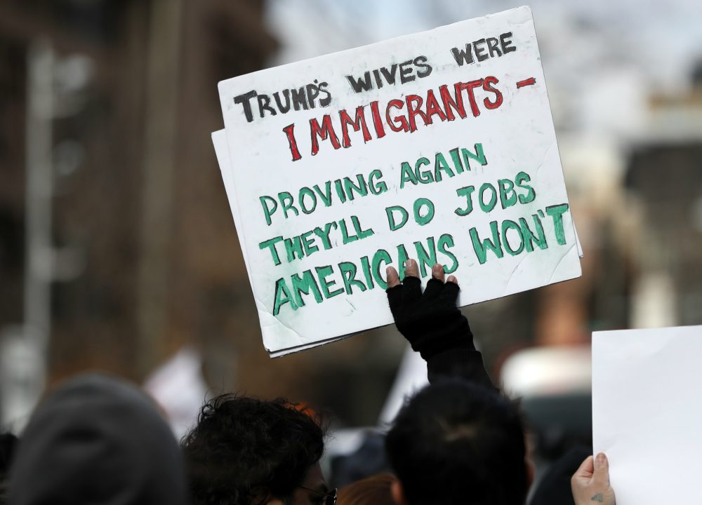 For the 74 percent of registered voters who voted for someone else, or who didn't vote at all, writes Steve Almond, Trump has been a walking anxiety attack. Pictured: A protester holds a sign during a Day Without Immigrants protest, Thursday, Feb. 16, 2017, in Washington. (Alex Brandon/AP)
