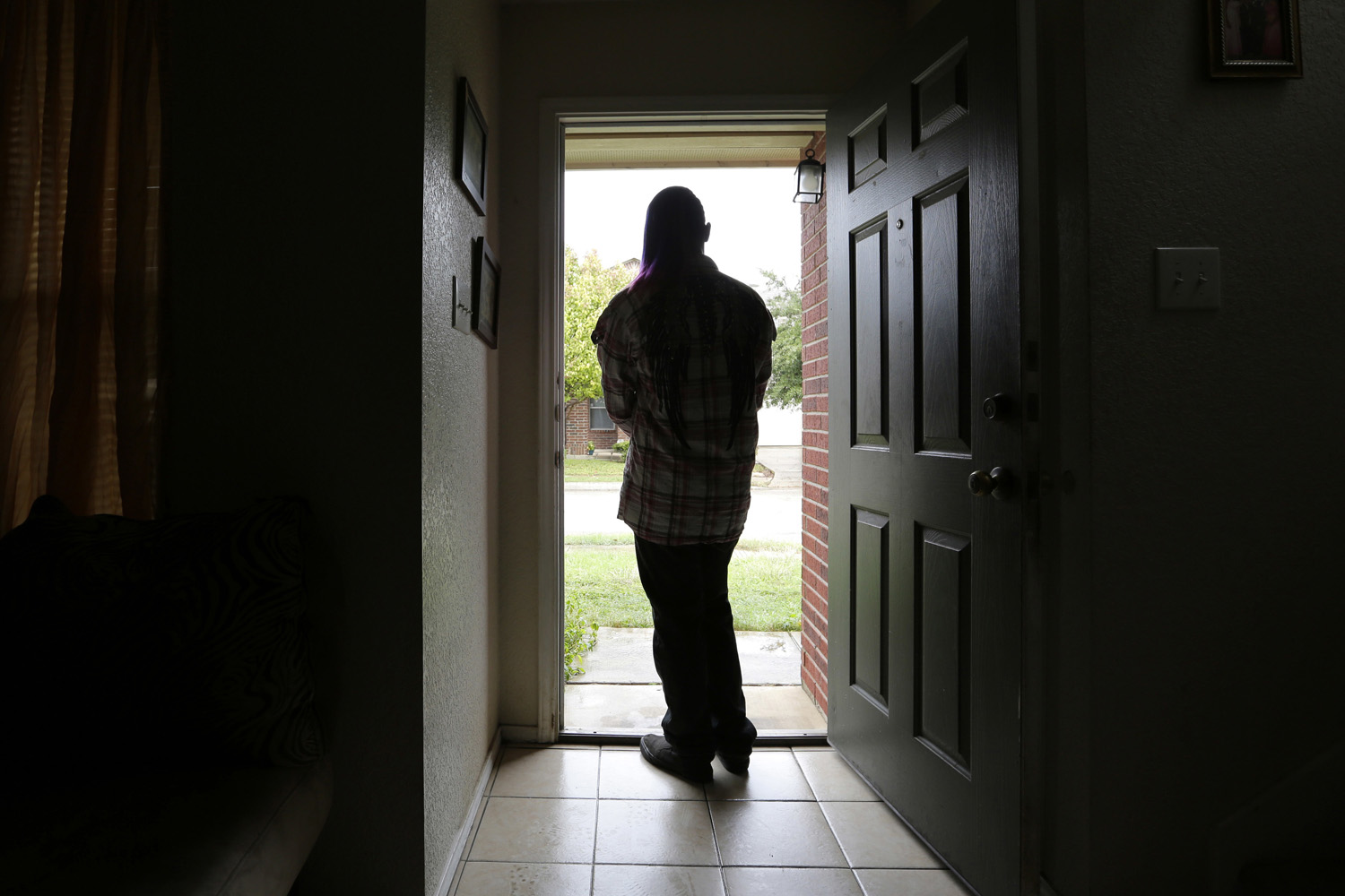 In this Monday, Dec. 5, 2016 file photo, a 19-year-old transgender teen, who declined to be identified because she feared for her life after receiving death threats earlier in the year at a halfway house, poses for a photo in Texas. (Eric Gay/AP)