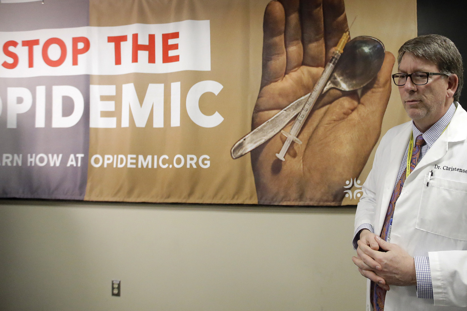 Dr. Erik Christensen, chief medical examiner at the Utah Department of Health, looks on during a press conference during their new campaign Stop the Opidemic. (Rick Bowmer/AP)