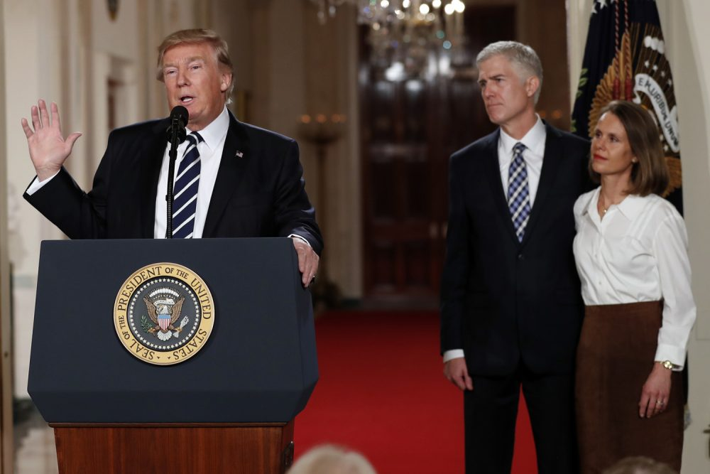 President Trump speaks in the East Room of the White House to announce Judge Neil Gorsuch as his nominee for the Supreme Court. Gorsuch stands with his wife Louise. (Carolyn Kaster/AP)