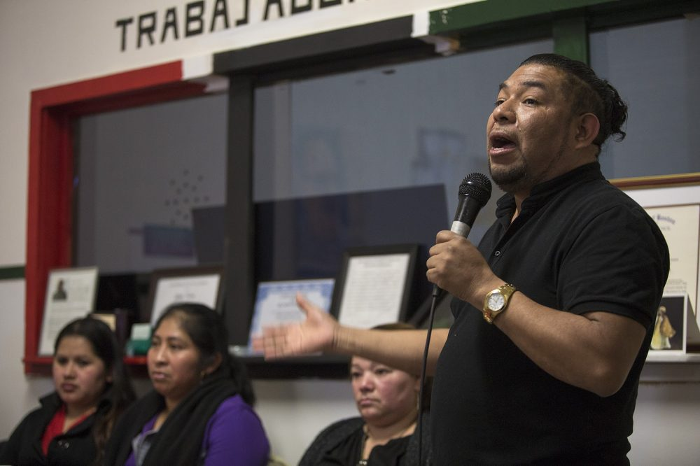 Adrian Ventura, director of Centro Comunitario Trabajadores (CCT), or Community Workers Center, in New Bedford speaks during a community meeting recognizing both 10th year anniversaries of CCT and the Michael Bianco factory raid. (Jesse Costa/WBUR)