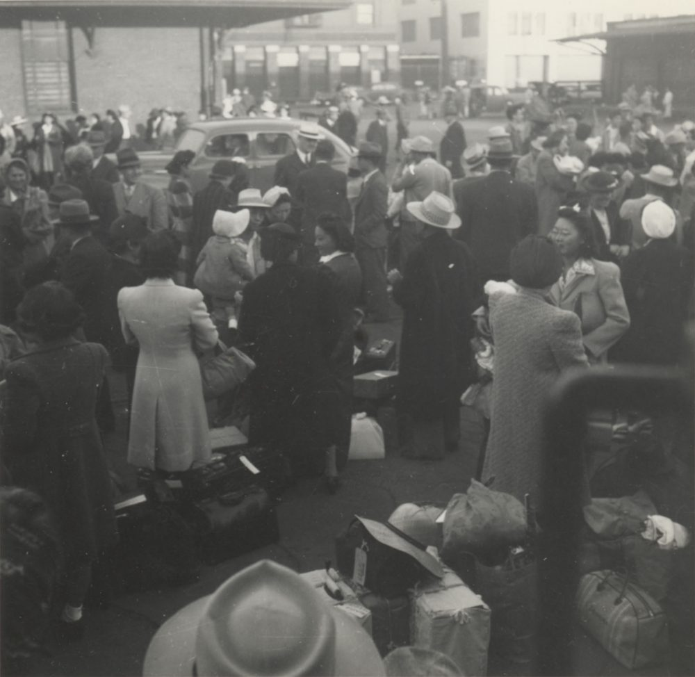 Japanese Americans wait at a Los Angeles, Calif., train station. They are bound for Parker, Ariz. (Poston concentration camp), May 29, 1942. (Courtesy Japanese American National Museum, gift of Susan K. Mochizuki and Ann K. Uyeda)
