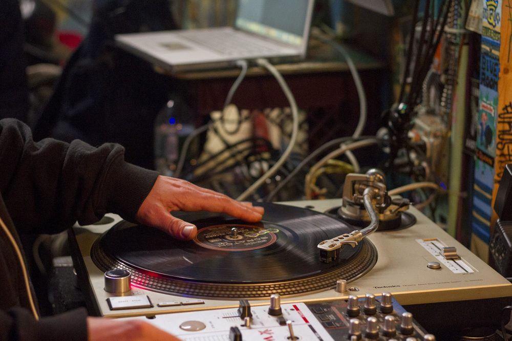A DJ spins records at the Freestyle Clinic. (Joe Difazio for WBUR)