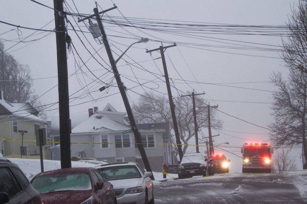 High winds took down a a light pole and power lines on Leverett Avenue in Revere. (Jesse Costa/WBUR)