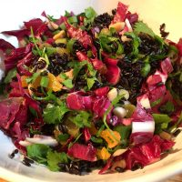 Kathy's warm black rice salad with apricots, almonds, raisins and radicchio. (Kathy Gunst for Here & Now)