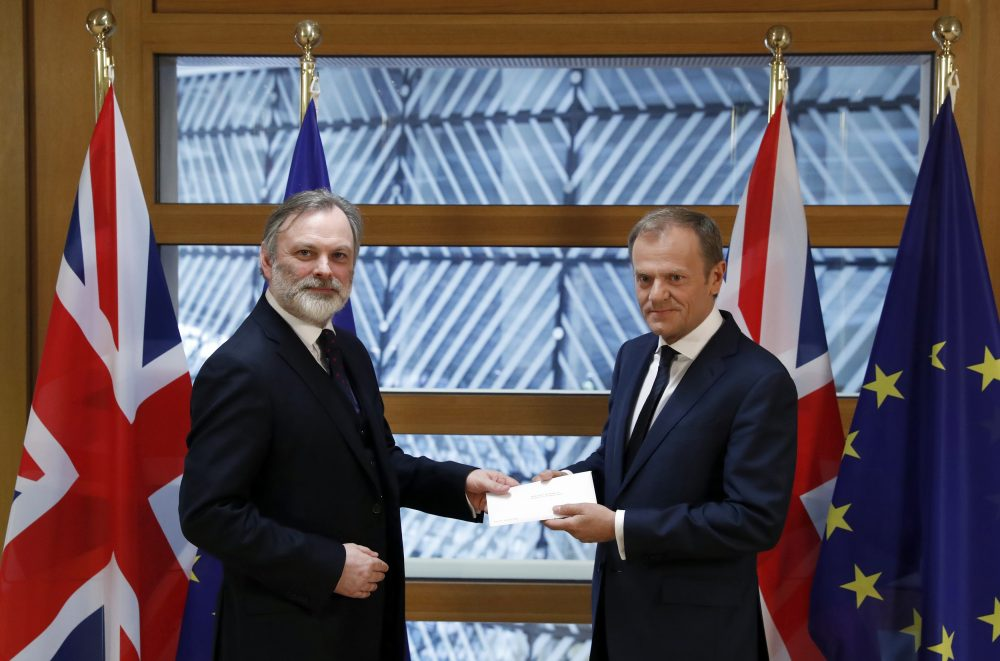 Britain's permanent representative to the European Union Tim Barrow, left, hands British Prime Minister Theresa May's Brexit letter in notice of the UK's intention to leave the bloc under Article 50 to EU Council President Donald Tusk on March 29, 2017. (Yves Herman/Pool Photo via AP)
