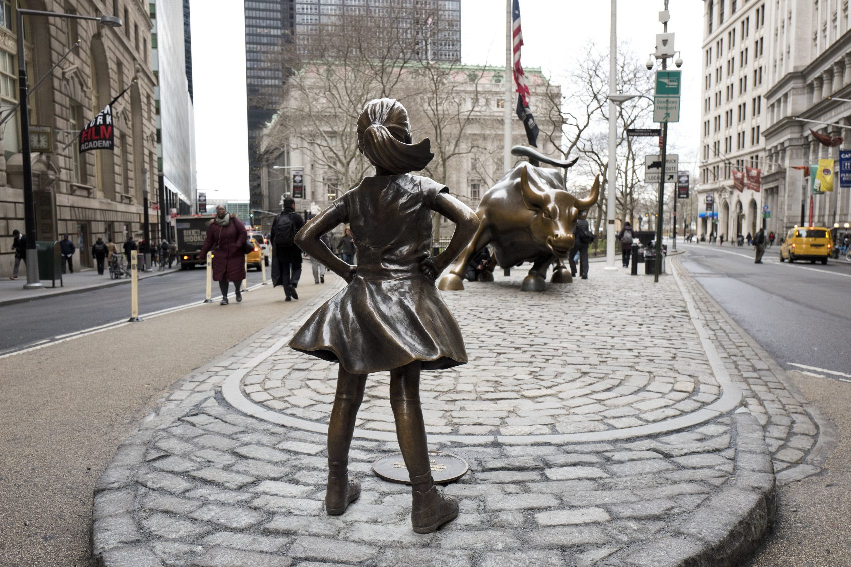 "The ""Fearless Girl"" statue faces Wall Street's charging bull statue in New York City. (Mark Lennihan/AP)"